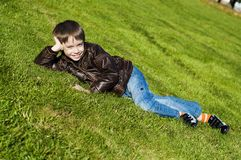 Little boy Lying Down on the  grass Stock Photo