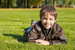 Little  boy Lying Down on the   grass Royalty Free Stock Photography