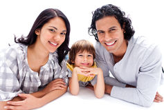 Little boy lying on the floor with his parents Royalty Free Stock Photos