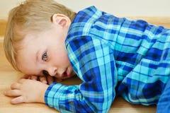 Little boy lying on floor Royalty Free Stock Photos