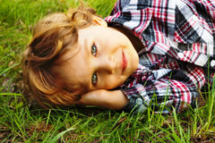 Little boy lying in the grass Royalty Free Stock Image