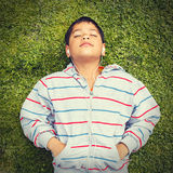 Little boy lying on the grass Royalty Free Stock Images
