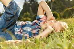 Little boy lying on the grass Stock Photography
