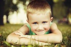 Little boy lying Stock Image
