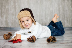Little boy, lying on the ground Royalty Free Stock Images