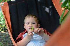 Little boy lying in a hammock Royalty Free Stock Photography