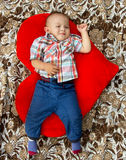 Little boy lying heart Stock Image