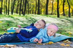 Little boy lying on his sister Royalty Free Stock Images