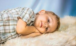 Little boy lying photographed in studio Christmas Stock Images