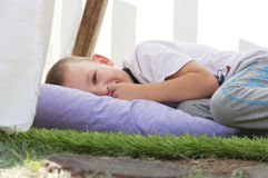 Little boy lying on a pillow Stock Photography