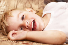 Little boy lying on sofa Stock Image