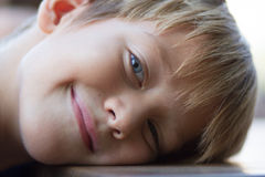 Little boy lying on the table Royalty Free Stock Photography