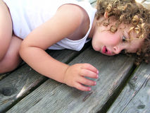 Little boy lying on the table Royalty Free Stock Images