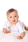 Little boy lying on tummy and smiling at camera Royalty Free Stock Images