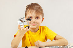 Little boy made something of mechanical constructor Stock Image