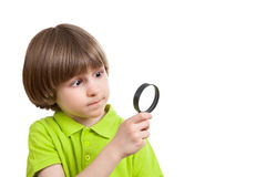 Little boy with magnifier glass Stock Images