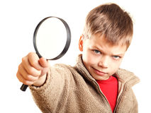 Little boy with magnifier Stock Photography