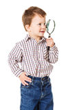 Little boy with magnifying glass Stock Photo