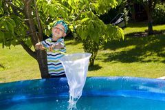 Little boy maintains the pool Royalty Free Stock Photo