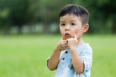 Little boy make a cute face. Asian young little boy at outdoor royalty free stock image