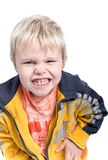 Little Boy Makes Funny Faces. A cute little blond-haired boy makes a funny face Royalty Free Stock Photos