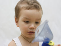 Little boy makes inhalation. Royalty Free Stock Image