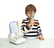 Little boy makes inhalation Royalty Free Stock Photo