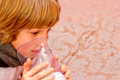 Little boy makes inhalation at home, taking medication to bronchial tubes. tube. Royalty Free Stock Photography