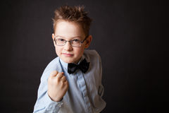 Little boy making angry face Stock Image
