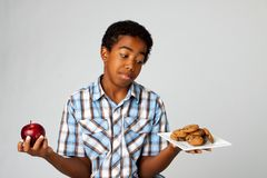 Free Little Boy Making Decisions Of Eating Healthy Verses Unhealthy. Stock Images - 99721044