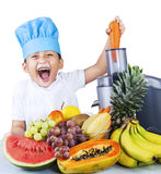 Little boy making fruit juice Stock Photo