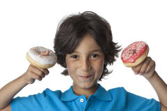 Little boy making fun with donuts. On white background Royalty Free Stock Photos