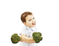 Little boy making funny face with broccoli Royalty Free Stock Image