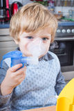 Little boy making inhalation with nebuliser Royalty Free Stock Photos