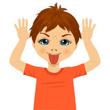 Little boy making mocking expression with hands Royalty Free Stock Photography