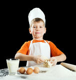 Little boy making pizza or pasta dough. Royalty Free Stock Photo