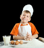 Little boy making pizza or pasta dough. Stock Image