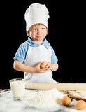 Little boy making pizza or pasta dough Stock Image