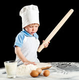 Little boy making pizza or pasta dough Stock Photography