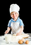 Little boy making pizza or pasta dough Royalty Free Stock Images