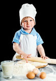 Little boy making pizza or pasta dough Stock Photo