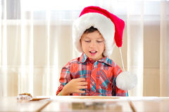 Little boy making preparations for baking cookies Stock Image