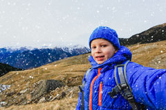 Little boy making selfie while travel in mountains Royalty Free Stock Images