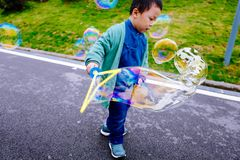 Little boy making soap bubbles Stock Photography