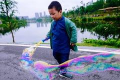 Little boy making soap bubbles Royalty Free Stock Photos