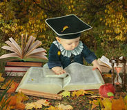 Little boy with many books in park collage