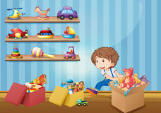 Little boy and many toys Stock Photos