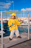 Little boy at marina pier Royalty Free Stock Photo