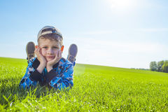 Little boy on meadow Royalty Free Stock Image