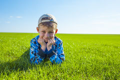 Little boy on meadow Stock Photos
